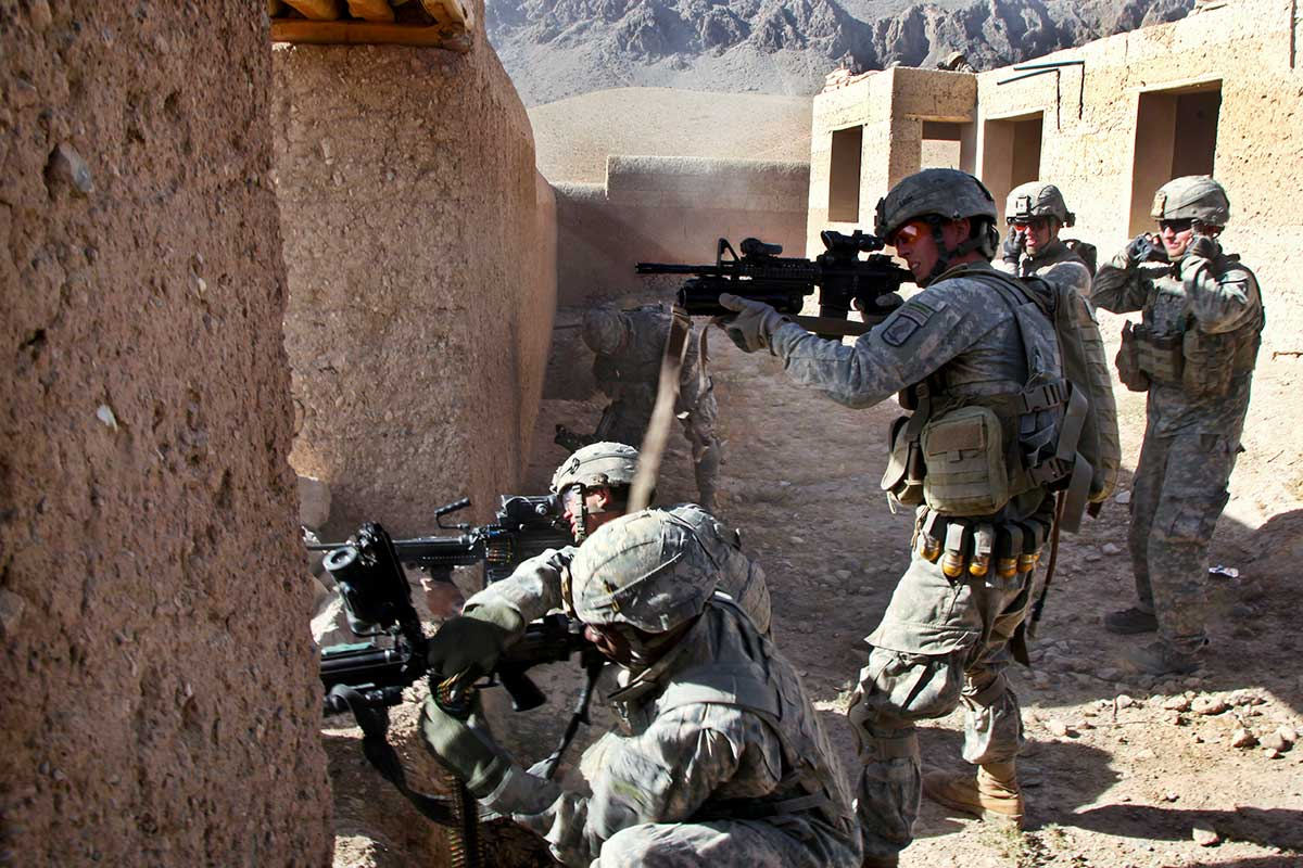 Soldiers engage enemy combatants.